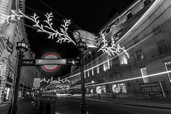 Regent Street (Daniel Coyle) Tags: christmas longexposure nightphotography blackandwhite bw london night underground lights nikon nightshot regentstreet christmaslights piccadillycircus lighttrails londonnight undergroundstation nightonearth londonchristmas danielcoyle d3100 nikond3100 christmas2014 nightatthemuseum3 regentstreetchristmaslights2014