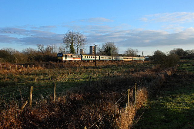 73 210 Selhurst departs from Wymondham Abbey