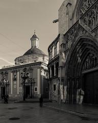 Portal of the Apostles (entrance to Bascilica of Our Lady) & Bascilica Virgin de los Desamparados - Valencia (BW - Cream Tone) (Panasonic Lumix LX100) (markdbaynham) Tags: street leica city our valencia monochrome lady lens four lumix spain zoom cream panasonic virgin espana spanish espanol third fixed ft metropolis portal es tone apostles 43rd ciutat lx desamparados bascilica evf dmclx lx100 2475mm f1728 dmclx100