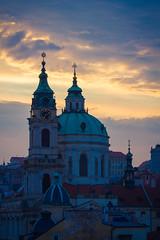Saint Nicholas (AmokCanadian) Tags: travel blue sunset tourism church architecture clouds canon eos gold is purple prague religion atmosphere dreamy feeling 70200 f4 550d t2i