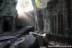 Angkor Wat (GuyBerresfordPhotography.co.uk) Tags: door travel trees sun tree tourism window stone stars temple asia cambodia southeastasia khmer buddhist steps ruin earlymorning roots entrance angkorwat tourist doorway bark blocks root siemreap taprohm hindu ta tombraider sculptures beams banyan indianajones ruined lightrays bayon angkorthom tasom prohm raidersofthelostark hundu