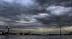 Storm of Riga (IVAN 63) Tags: city sky water bay cityscape baltic latvia riga lettonia baltico vecriga vansu sulladaugava vansupontesospeso vansutheriverdaugava vansususpensionbridge