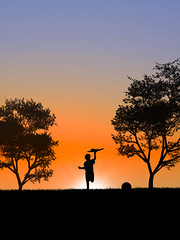 Follow your dreams (the_wonderer_wanderer) Tags: boy sunset sun playing childhood backlight plane ball fun happy kid play happiness follow dreams silouhette