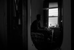 pause. (jonathancastellino) Tags: leica cambridge portrait usa reflection window america ma mirror bed friend solitude quiet sit pause seated gaze