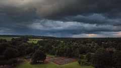 A place to play tennis. ( www.ethanleephoto.com) Tags: life uk travel tree green court moving nikon mood afternoon view cloudy snap tennis gb british 24mm nikkor f35 pce  tiltshit d810