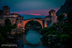 Rebuild (Alex Chilli) Tags: old city travel bridge blue light sunset red summer sky orange beautiful architecture canon river lens eos evening town amazing glow arch view dusk mostar bosnia sigma best stunning vista lit balkans rebuilt 70d