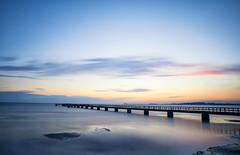 Eventide (Appe Plan) Tags: ocean bridge sunset summer sky sun lund water colors clouds port skne nikon soft long exposure colours sweden jetty south silk down le lee nd setting filer appe d700 bigstopper