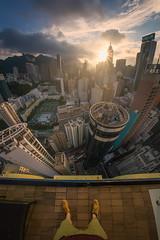 On The Edge (albert dros) Tags: travel sunset buildings hongkong asia cityscape skyscrapers vertigo sunburst selfie sunstar albertdros