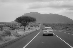 Arusha (Da Traveler) Tags: freeway blackandwhite road monochrome highway hill mountain cars lonely alone tree bangladeshi photographer kamrul hasan tanzania africa