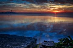 Sun up in Toronto (Greg David) Tags: blue light sky lake toronto ontario water clouds sunrise first lakeshore lakeontario torontoskyline ontariolandscape torontosunrise lakeontariosunrise