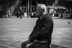 The Waiting (Leanne Boulton) Tags: life street old city uk light shadow portrait people urban blackandwhite bw white man black detail male texture monochrome face look canon bench 50mm reflecting mono scotland living blackwhite sitting natural emotion humanity outdoor expression glasgow candid character culture streetphotography streetlife scene human elderly age shade portraiture 7d aged feeling breeze society depth tone facial candidportrait candidstreetphotography