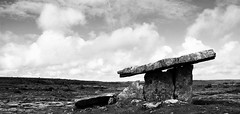 Things Remote (little_frank) Tags: ireland summer sky blackandwhite bw history architecture clouds wonder fantastic ancient scenery clare cloudy magic memory burren balance alive past magical mystic antiquity standingstone prehistory primordial primeval poulnabronedolmen