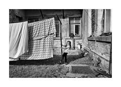 Courtyard (Jan Dobrovsky) Tags: bw contrast countrylife countryside document girl grain krasnalipa leicaq outdoor portrait rural village gypsies