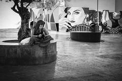 Pepe Reyes160822-019 (Pepe Reyes (jorego)) Tags: 2016 málaga bn barrios centro elpimpi fotografíacallejera graffiti granada mujer móvil sentada streetphotography