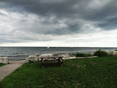 incoming storm (Lovely Pom) Tags: storm sea ocean lake water sailing dark clouds bench rocks weather rain winds