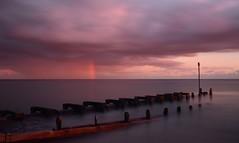 Pipe Dreams.... (hall1705) Tags: pipedreams rainbow pipe water wastepipe westsussex worthing pink duskypink clouds rain sea shore seascape seaside d3200 longexposure