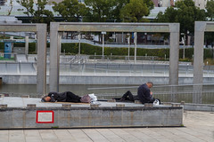 Tired in Osaka (Tuck Happiness) Tags: park sleeping man japan concrete cardboard tired   osaka 2014 ogimachi