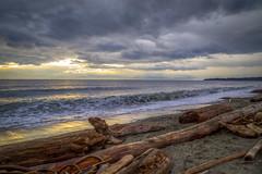Evening Surf (Paul Rioux) Tags: sunset seascape beach clouds evening surf waves bc dusk britishcolumbia logs victoria vancouverisland driftwood seashore prio colwood esquimaltlagoon coburgpeninsula