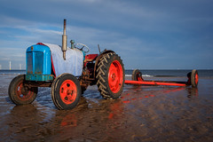Walking along Redcar beach (archangel 12) Tags: sea fish tractor beach fishing yorkshire lowtide fishingboat redcar ici panasoniclumixgvario45200mmf4056 olympusmzuikodigitaled1250mm13563ez redcaroffshorewindfarm