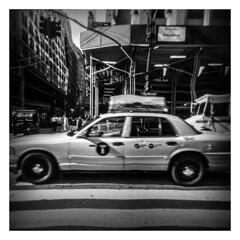 Speeding (Jess Ayotte) Tags: street camera nyc newyorkcity people blackandwhite white ny newyork black 120 film analog buildings project toy holga surrealism cab taxi assignment dream surreal warped liquify luciddream
