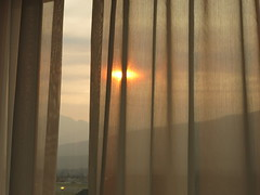 early evening sun from our hotel room - HWW! (karma (Karen)) Tags: windows sun canada topf25 haze jasper smoke alberta curtains hotels canadianrockies jaspernp viewbeyond canadanationalparks