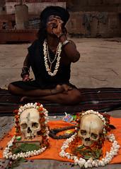 aghori sadhu (magbrinik) Tags: flowers skulls skull smoke varanasi spirituality utt holyman benares preghiera antropologia santone chilum manikarnikaghat pujs smokingtime youngsadhu sadhuportrait aghorisadhu antropologye blacksadhu