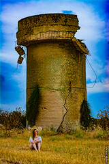 Relax at the field (barak.shacked) Tags: sky woman tower field yellow female spring alone sitting wheat watertower bluesky oldbuilding abandonedbuildings wating oldtower