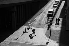 Get Going (Places, Faces) Tags: street city uk travel bridge light england people urban blackandwhite bw sunlight streets london monochrome lines outdoors mono shadows angle britain centre central streetphotography silhouettes streetscene scene streetphoto crossroads peoplewatching arielview londonstreets urbanstreets robmchale