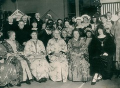Japanese Bazaar at Elswick Road Wesleyan Church (Tyne & Wear Archives & Museums) Tags: 1920s portrait men industry window glass hat wall glitter standing 1932 religious shoe japanese necklace interesting chair women shoes pattern shine lordmayor dress floor unitedkingdom interior room text religion leg banner decoration hats jewellery event frame signage archives service ribbon unusual sheriff 1912 bazaar stocking methodism seated occasion tyneside newcastleupontyne fascinating 1877 digitalimage blyth socialevent citycouncil alderman socialhistory northeastengland wesleyanchurch blackandwhitephotograph 19241925 northeastofengland 19361937 cityofnewcastleupontyne servingthecity ladysheriff johngrantham elswickroad elswickroadwesleyanmethodistchurch japanesebazaar cinemaproprietor 11march1925 violetgrantham elswickroadmethodistchurch
