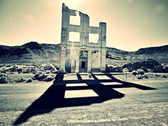 history casts a long shadow... (BillsExplorations) Tags: old shadow mountains abandoned vintage ruins decay nevada historic mining ghosttown rhyolite sierranevada deserted arid stockexchange