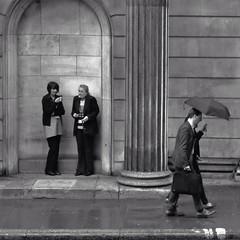 Shelter (Douguerreotype) Tags: street city uk england people urban bw 3 london monochrome rain mono britain candid gb urbex