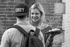 Obey Cheese (Dennis van Mierlo) Tags: boy bw white black girl smile hat cheese hair long obey streetphotography plate blond backpack
