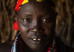 Toposa tribe woman with scarified face, Omo valley, Kangate, Ethiopia (Eric Lafforgue) Tags: africa people color face horizontal outdoors necklace women day adult african traditional decoration jewelry tribal indoors bead omovalley ethiopia tribe scar marking bizarre cultural scarification bodymodification oneperson adornment hornofafrica ethiopian eastafrica abyssinia traditionalclothing realpeople darkskin beadednecklace bume onewomanonly lookingatcamera humanskin 1people scarified africanculture toposa humanbodypart topossa kangate kangatan ngakaaly ethio161646