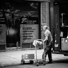 Office Services (petertandlund) Tags: city nyc people urban blackandwhite bw newyork man blancoynegro monochrome square streetphotography documentary streetscene delivery bnw xe1 fujix