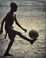 night game (Pejasar) Tags: africa boy shirtless game childhood silhouette ball dark foot football child play kick soccer ghana barefoot westafrica nightgame ashaimbre