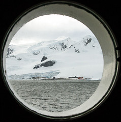 Chilean Air Force Base from our Porthole _MG_7742 resized (Robyn Aldridge) Tags: white snow seascape mountains colour texture ice beach nature water clouds buildings landscape outdoors coast rocks wasser patterns shapes antarctica textures boulders porthole coastline summertime snowscape waterscape outpost icescape antarcticpeninsula waterboatpoint akademikioffe lrcc pscc canon7d tamron18270mm chileanairforcebase