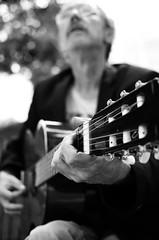 Give me a blues man 2 (Claudio Taras) Tags: claudio contrasto controluce bluesman taras trier street shadow streetshot bw strada chitarra guitar bokeh biancoenero monocromo monochrom portrait people musicista persone artista artist