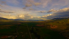 Lemhi Valley Stormscape 20 (Dan Beland) Tags: sky usa cloud art nature water field grass clouds fence landscape unitedstates artistic outdoor hill idaho pasture valley vista northamerica rockymountains verdant serene lush cloudscape barbedwirefence mountainscape drone cloudreflections dji beaverheadmountains salmonidaho quadcopter lemhicounty phantom3professional lemhirivervalley