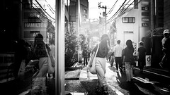 .lost in thoughts all alone. (Shirren Lim) Tags: tokyo monochrome people japan graphic lines abstract outdoor symmetry street photography building structure architecture infrastructure harajuku flare sunset fuji bw
