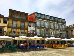 square (ekelly80) Tags: portugal guimares june2016 summer braga minho town square largodaoliveira olivesquare cafes buildings architecture alfresco umbrellas