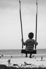 swinging on the beach (G.Don) Tags: ocean sea summer portrait bw white black beach playground fuji swing shore peole xe1 contaxyashicazeisstessart452845mmf208portraitblackwhitebw
