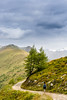Hiking along the mountain tops (Raoul Pop) Tags: autumn trees sky people woman mountains fall colors clouds canon walking austria afternoon hiking backpack shrubs ligia mountaintops osttirol canoneos5d at nearmatrei