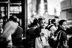 Happiness Trumps Scowl (sagepatchwork) Tags: street nyc newyorkcity blackandwhite bw ny newyork bokeh candid sony streetphotography scowl alpha slt a77 85mm14