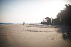 morning light (paul.wienerroither) Tags: morning travel light sun beach canon photography 50mm lights view surfer srilanka lensflares arugambay mainpoint