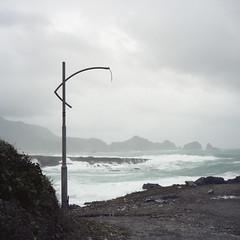 hanging on (Tom Kondrat) Tags: sea mountains 120 6x6 film broken lamp port mediumformat rocks waves harbour taiwan before analogue mamiya6 typhoon goni kodakportra160 typhoonblues