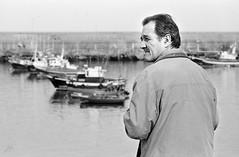 Where am I going? (I'M (Iris Martnez)) Tags: man blancoynegro analog boats blackwhite barcos asturias monocromatic hombre cudillero analgico monocromtico filmkodak400