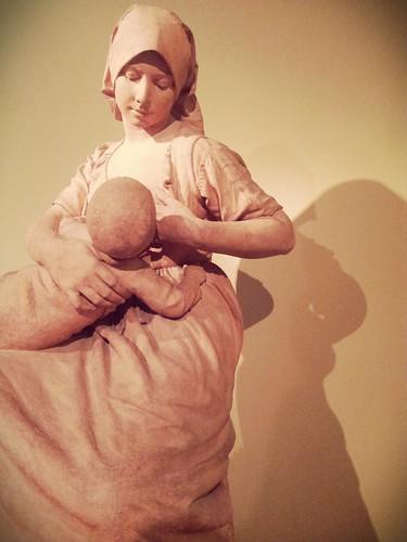 Peasant woman nursing a baby by Aimè-Jules Dalou