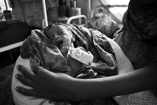 A mother holds her newborn child in the hospital in Kakuma Refugee Camp, Kenya.