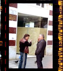 Smalltalk (Chris Vidouras) Tags: street men film canon hand cigarette pigeons streetphotography bodylanguage talk greece 400 thessaloniki fujifilm 500n filmphotography canon500n canonphotography