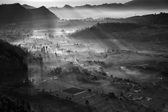 The God Rays (eggysayoga) Tags: city morning bw bali cliff white mist black fog sunrise indonesia landscape nikon village sigma os mount rays f28 rol 70200mm matahari godrays kintamani desa d810 kabut pinggan